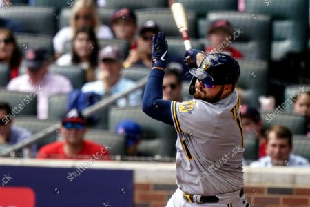 Milwaukee Brewers' Rowdy Tellez (11) strikes out against Atlanta Braves starting pitcher Ian Anderson during the fourth inning of Game 3 of a baseball National League Division Series, in Atlanta