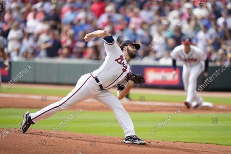 Atlanta Braves starting pitcher Ian Anderson (36) works against the Milwaukee Brewers during the first inning of Game 3 of a baseball National League Division Series, in Atlanta