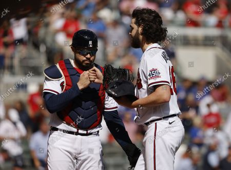 Atlanta Braves starting pitcher Ian Anderson (R) is greeted by Atlanta Braves catcher Travis d'Arnaud (L) after an inning against the Milwaukee Brewers of game 3 of the National League Division Series MLB playoff baseball game between the Milwaukee Brewers and the Atlanta Braves at Truist Park in Atlanta, Georgia, USA, 11 October 2021.