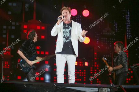 Stock Image of Duran Duran's Simon Le Bon, center, performs with John Taylor, left, and Dominic Brown on day three of the Austin City Limits Music Festival's second weekend, in Austin, Texas