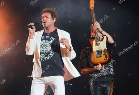Duran Duran's Simon Le Bon, left, and Dominic Brown perform on day three of the Austin City Limits Music Festival's second weekend, in Austin, Texas
