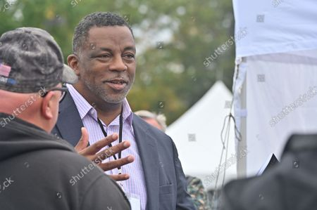 Daryl Brooks, Radio Talk Show Host, and three time US Senate and Congressman candidate talks to men at the Rod of Iron Freedom Fest about his book 37 Days: The Disenfranchisement of a Philadelphia Poll Worker. The Rod of Iron Freedom Festival is an anti-government, Christian far-right movement that held a 3 day 2nd Amendment Rally of Freedom, Faith and Family. A few far right politicians were in attendance and the event featured a speech from HJ Sean Moon, the founder of the  World Peace and Unification Church in Pennsylvania, who often wears a crown made of bullets. Members take marriage vows to their AR-15 rifles and have blessings for their guns. Many in attendance were seen carrying guns.