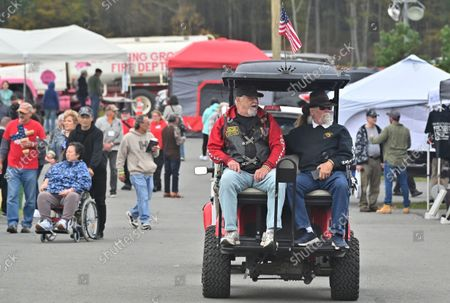Combat veterans are given a ride through the Freedom Fest 2nd Amendment grounds. The Rod of Iron Freedom Festival is an anti-government, Christian far-right movement that held a 3 day 2nd Amendment Rally of Freedom, Faith and Family. A few far right politicians were in attendance and the event featured a speech from HJ Sean Moon, the founder of the  World Peace and Unification Church in Pennsylvania, who often wears a crown made of bullets. Members take marriage vows to their AR-15 rifles and have blessings for their guns. Many in attendance were seen carrying guns.
