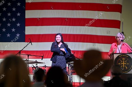 Stock Image of Amanda Suffecool a radio host moderated a concealed weapon fashion show at the Rod of Iron Freedom Fest. The Rod of Iron Freedom Festival is an anti-government, Christian far-right movement that held a 3 day 2nd Amendment Rally of Freedom, Faith and Family. A few far right politicians were in attendance and the event featured a speech from HJ Sean Moon, the founder of the  World Peace and Unification Church in Pennsylvania, who often wears a crown made of bullets. Members take marriage vows to their AR-15 rifles and have blessings for their guns. Many in attendance were seen carrying guns.