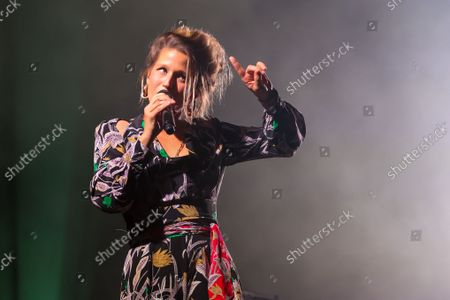 """Stock Photo of Belgian singer-songwriter Selah Sue performs on stage during the 30th edition of the """"Fiesta des Suds"""" music festival in Marseille. Selah Sue has won the Best Female Solo Artist award five times at the Music Industry Awards."""