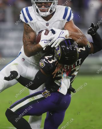 Stock Photo of Indianapolis Colts WR Michael Pittman Jr (11) makes what would become a touchdown reception as Baltimore Ravens CB Anthony Averett (23) defends during the third quarter of a game at M&T Bank Stadium in Baltimore, Maryland on Photo/ Mike Buscher / Cal Sport Media