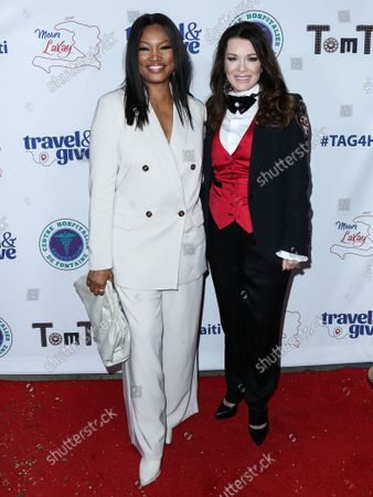 Actress Garcelle Beauvais and restaurateur Lisa Vanderpump-Todd arrive at Travel and GIVE's 4th Annual 'Travel With A Purpose' Fundraiser (Fundraiser to Benefit Teletherapy Program and Communities in Haiti Affected by Earthquake) held at TOM TOM Restaurant and Bar on October 11, 2021 in West Hollywood, Los Angeles, California, United States.