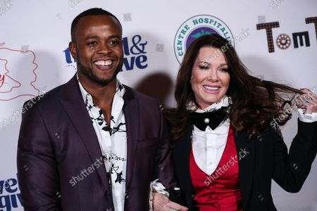 Actor Richardson Chery and restaurateur Lisa Vanderpump-Todd arrive at Travel and GIVE's 4th Annual 'Travel With A Purpose' Fundraiser (Fundraiser to Benefit Teletherapy Program and Communities in Haiti Affected by Earthquake) held at TOM TOM Restaurant and Bar on October 11, 2021 in West Hollywood, Los Angeles, California, United States.