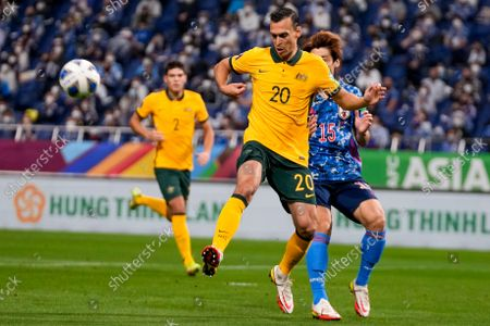 Stock Picture of Australia's Trent Sainsbury, left, and Japan's Yuya Osako compete for the ball during their World Cup 2022 group B qualifying soccer match between Australia and Japan at Saitama Stadium in Saitama, north of Tokyo