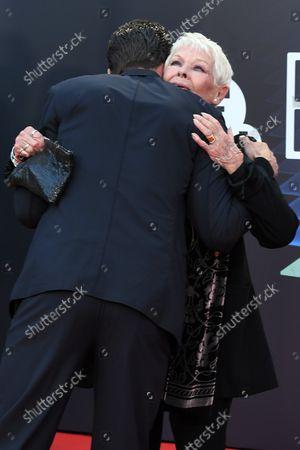 Jamie Dornan and Dame Judi Dench