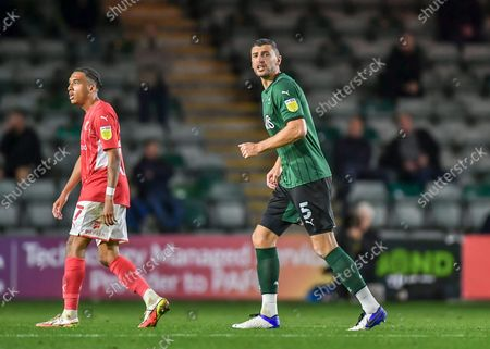Plymouth Argyle defender James Wilson  (5) shouts instructions to his teammates  during the EFL Trophy match between Plymouth Argyle and Swindon Town at Home Park, Plymouth