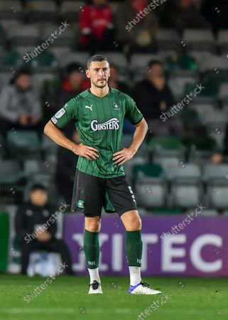 Plymouth Argyle defender James Wilson  (5) looks dejected after conceding a goal during the EFL Trophy match between Plymouth Argyle and Swindon Town at Home Park, Plymouth