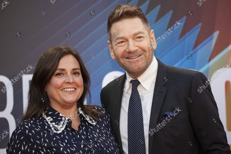 Kenneth Branagh, right, and Lindsay Brunnock pose for photographers upon arrival at the premiere of the film 'Belfast' during the 2021 BFI London Film Festival in London