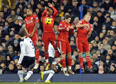 David N'Gog of Liverpool gives away a penalty from Gareth Bale of Tottenham Hotspurs' free kick