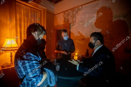 Stock Picture of Jimmy Holguin is a magician in the dark arts lounge at the Haunted House Delusion where guests have an immersive entertainment experience at Phillips Mansion in Pomona on Sunday, Oct. 10, 2021. (Allen J. Schaben / Los Angeles Times)