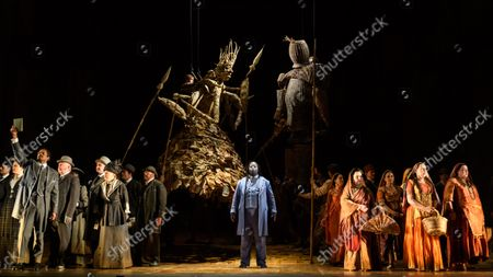 Stock Image of English National Opera presents Philip Glass's 'Satyagraha' at the London Coliseum.  This production is directed by Phelim McDermott with Peter Relton as revival director, set design by Julian Crouch, costume design by Kevin Pollard, and lighting design by Paule Constable, with revival lighting direction by Kevin Sleep. Revival movement direction and puppetry are by Rob Thirtle, with video design by 59 Productions. Carolyn Kuan makes her ENO debut, as conductor. The cast is: Sean Panikkar (M K Gandhi), Musa Ngqungwana (Lord Krishna), William Thomas (Parsi Rustomji), Sarah Pring (Mrs Alexander), Verity Wingate (Mrs Naidoo), Felicity Buckland (Kasturbai), Gabriella Cassidy ( Miss Schlesen), James Cleverton (Mr Kallenbach), Ross Ramgobin (Prince Arjuna). Picture shows: Sean Panikkar (MK Gandhi), Musa Ngqungwana (Lord Krishna)