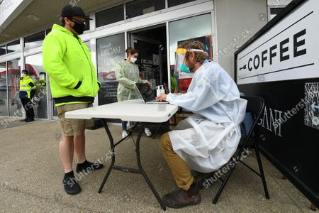 Andrew Johnson speaks with a healthcare worker prior to receiving a Covid19 vaccination at a pop-up vaccination van in Epping, Melbourne, Australia, 13 October 2021. Neighbourhood vaccination clinics are being established at cafes, shops and gyms to ramp up COVID-19 inoculation coverage in Victorians.