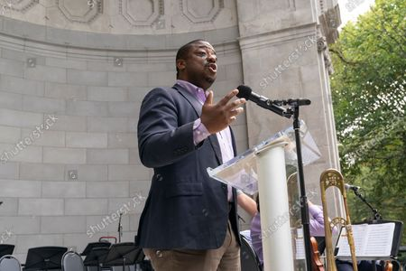 Stock Photo of Lieutenant Governor Brian Benjamin speaks at Local 802 AFM Centennial celebration at Central Park. Musicians, union members of Local 802 could not perform live during heights of pandemic and therefore lost their income. They rely on support by the union and money allocated by the city, state and federal governments. Since the pandemic receded musicians again started to perform for the public and they celebrated the centennial of their union with elected officials and performing for the crowd in the park.