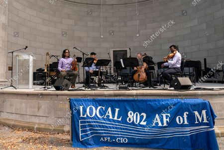 Musicians perform during Local 802 AFM Centennial celebration at Central Park. Musicians, union members of Local 802 could not perform live during heights of pandemic and therefore lost their income. They rely on support by the union and money allocated by the city, state and federal governments. Since the pandemic receded musicians again started to perform for the public and they celebrated the centennial of their union with elected officials and performing for the crowd in the park.