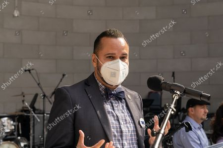 State senator Jose Serrano speaks at Local 802 AFM Centennial celebration at Central Park. Musicians, union members of Local 802 could not perform live during heights of pandemic and therefore lost their income. They rely on support by the union and money allocated by the city, state and federal governments. Since the pandemic receded musicians again started to perform for the public and they celebrated the centennial of their union with elected officials and performing for the crowd in the park.