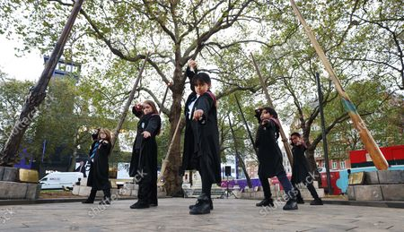 A dazzling installation of Wizarding World wands is unveiled in Leicester Square by Paul Harris, the wand choreographer for Harry Potter and the Order of the Phoenix, hosting a wand lesson for children from Park View Haringey School. The display has launched in partnership with Discover Leicester Square to celebrate the 20th Anniversary of the Harry Potter and the Philosopher's Stone film, which returns to UK and Ireland cinemas on 29th October