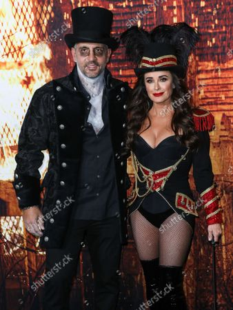 Real estate agent Mauricio Umansky and wife/actress Kyle Richards arrive at the Costume Party Premiere Of Universal Pictures' 'Halloween Kills' held at the TCL Chinese Theatre IMAX on October 12, 2021 in Hollywood, Los Angeles, California, United States.