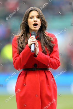 Faryl Smith sings the national anthems before kick-off