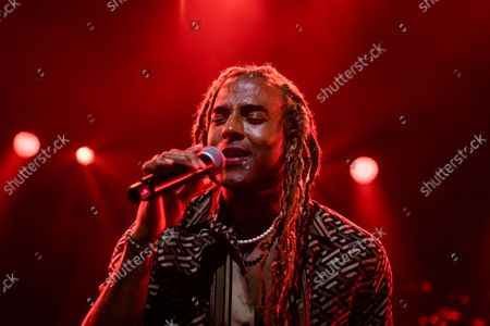 Stock Photo of Yotuel Romero performs at the 2021 Hispanidad Concert held on October 12, 2021, at the Wizink Center, Madrid, Spain, organized by the Instituo del Espanol de la Comunidad de Madrid.