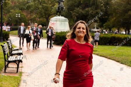 Canadian Finance Minister Chrystia Freeland smirks as she flees a press conference at the White House during a protest by indigenous leaders against Enbridge and the Line 3 pipeline.  She left immediately when asked about the protest and Enbridge.  Native American activists the continued use of fossil fuels in general, and Line 3 specifically.