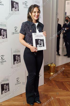 Tamara Falco poses for photo during the presentation of her book 'Las recetas de casa de mi madre',  (recipes from my mother's house).