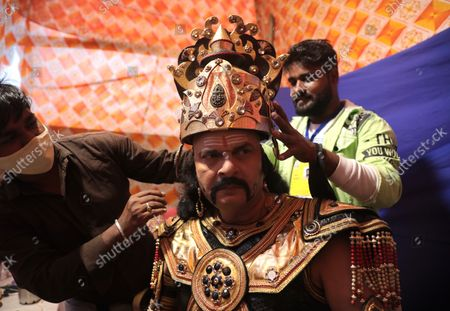 An Indian artist dressed as demon king Ravana prepares backstage before performing in the traditional annual Lord Rama play called 'Ramleela' at Luv Kush Ramleela in New Delhi, India, 13 October 2021. Ramleela (or Ramlila) is a folk performance of the life of Hindu god Rama according to the epic story of 'Ramayana,' which was written more 2,000 years ago and consists of twenty-four thousand couplets, attributed to the poet Valmiki.