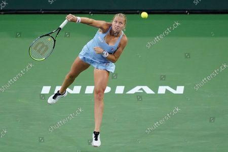 Shelby Rogers serves to Jelena Ostapenko, of Latvia, at the BNP Paribas Open tennis tournament, in Indian Wells, Calif