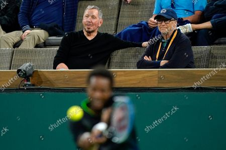 Stock Image of Oracle co-founder Larry Ellison, upper left, sits with Microsoft co-founder Bill Gates as Gael Monfils, of France, returns a shot to Alexander Zverev, of Germany, at the BNP Paribas Open tennis tournament, in Indian Wells, Calif
