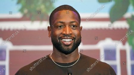 Stock Image of All-Star Dwyane Wade speaks during a news conference, in Salt Lake City. Apple CEO Tim Cook and Wade joined Utah leaders to announce the completion of a local advocacy group's campaign to build eight new homes for LGBTQ youth in the U.S. West