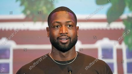 Stock Photo of All-Star Dwyane Wade speaks during a news conference, in Salt Lake City. Apple CEO Tim Cook and Wade joined Utah leaders to announce the completion of a local advocacy group's campaign to build eight new homes for LGBTQ youth in the U.S. West