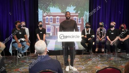All-Star Dwyane Wade speaks during a news conference, in Salt Lake City. Apple CEO Tim Cook and Wade joined Utah leaders to announce the completion of a local advocacy group's campaign to build eight new homes for LGBTQ youth in the U.S. West