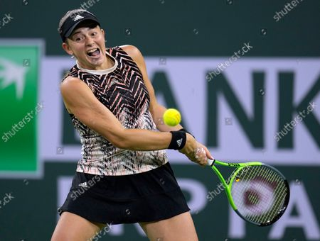Jelena Ostapenko of Latvia in action against Shelby Rogers of the US at the BNP Paribas Open tennis tournament at the Indian Wells Tennis Garden in Indian Wells, California, USA, 13 October 2021.