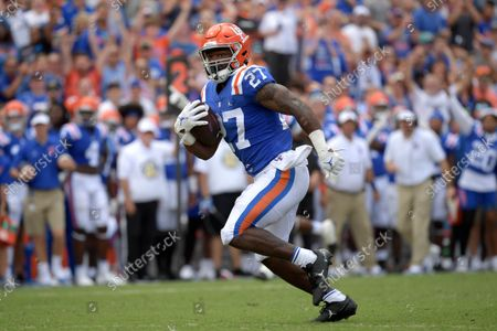 Florida running back Dameon Pierce (27) runs after catching a pass in front of Vanderbilt cornerback Jaylen Mahoney and linebacker Brayden DeVault-Smith for a 61-yard touchdown during the second half of an NCAA college football game, in Gainesville, Fla