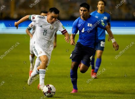 Stock Picture of Mexico's Carlos Alberto Rodriguez, left, and El Salvador's Isaac Portillo battle for the ball during a qualifying soccer match for the FIFA World Cup Qatar 2022 at Cuscatlan stadium in San Salvador, El Salvador