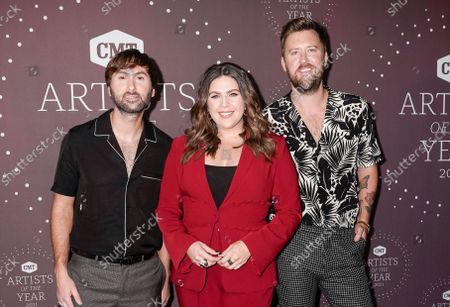 Lady A - Dave Haywood, Hillary Scott and Charles Kelley attend the 2021 CMT Artist of the Year on October 13, 2021 in Nashville, Tennessee.