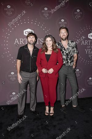 Stock Image of Lady A - Dave Haywood, Hillary Scott and Charles Kelley attend the 2021 CMT Artist of the Year on October 13, 2021 in Nashville, Tennessee.