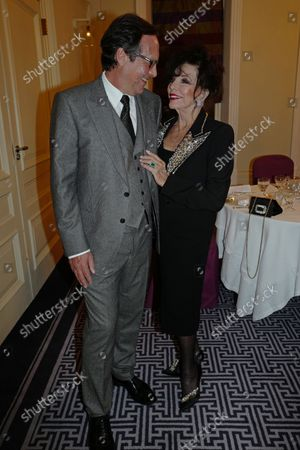 Stock Photo of Percy Gibson and Dame Joan Collins