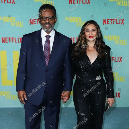 Actor Richard Lee Lawson and wife/businesswoman Tina Knowles Lawson arrive at the Los Angeles Premiere Of Netflix's 'The Harder They Fall' held at the Shrine Auditorium and Expo Hall on October 13, 2021 in Los Angeles, California, United States.