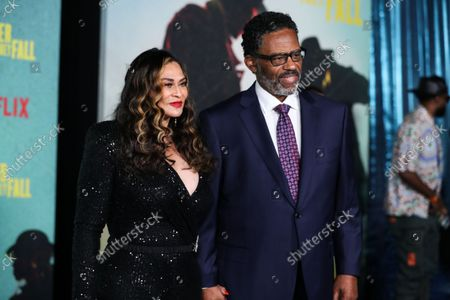 Businesswoman Tina Knowles Lawson and husband/actor Richard Lee Lawson arrive at the Los Angeles Premiere Of Netflix's 'The Harder They Fall' held at the Shrine Auditorium and Expo Hall on October 13, 2021 in Los Angeles, California, United States.