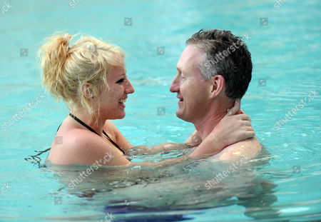 Lembit Opik and girlfriend Merily McGivern swimming in the pool at the Palazzo Versace Hotel