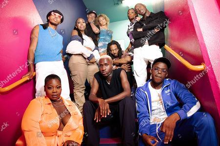 Standing: Mark Ashley-Dupe, Shannice, Tre, Isla Loba, Chantal, The Flag Twins. Sitting: Mojo, The Flag Twins, Gilly, Teeshow.