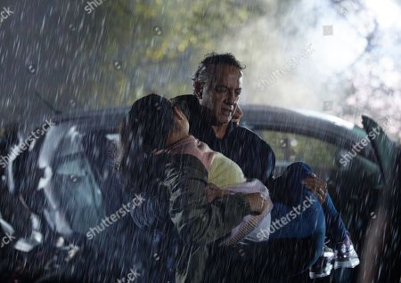 Coronation Street - Ep 10459 Monday 18th October 2021 - 2nd Ep As smoke seeps into the car Dev Alahan, as played by Jimmi Harkishin, has to decide whether to help Asha Alahan, as played by Tanisha Gorey, or Aadi Alahan. Believing Asha to be in more danger he goes to her aid and drags her away from the car.