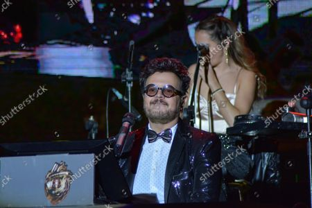 Stock Image of Mexican singer Aleks Syntek performs on stage a show during the 50th anniversary of Plaza Satelite mall at Plaza Sataelite