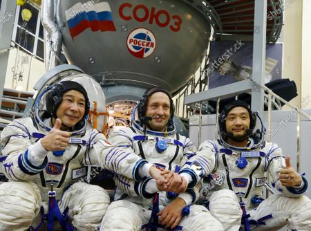 Roscosmos cosmonaut Alexander Misurkin, center, and space flight participants Yusaku Maezawa, left, and Yozo Hirano pose for a picture during a training session ahead of the expedition to the International Space Station at the Gagarin Cosmonauts' Training Center in Star City outside Moscow, Russia, . A Japanese fashion tycoon who's booked a SpaceX ride to the moon is going to try out the International Space Station first. Yusaku Maezawa announced that he's bought two seats on a Russian Soyuz capsule. He'll blast off in December on the 12-day mission with his production assistant and a professional cosmonaut