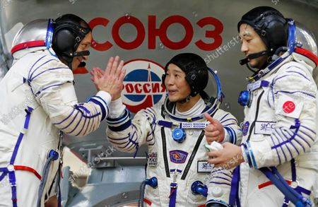 Roscosmos cosmonaut Alexander Misurkin, left, space flight participants Yusaku Maezawa, center, and Yozo Hirano attend a training session ahead of the expedition to the International Space Station at the Gagarin Cosmonauts' Training Center in Star City outside Moscow, Russia, . A Japanese fashion tycoon who's booked a SpaceX ride to the moon is going to try out the International Space Station first. Yusaku Maezawa announced that he's bought two seats on a Russian Soyuz capsule. He'll blast off in December on the 12-day mission with his production assistant and a professional cosmonaut